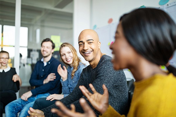 Group of diverse business people talking in a meeting. Business team smiling during a meeting.